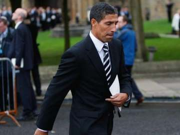 Hughton suited, now booted.
