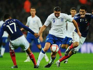 Andy Carroll in action against France.