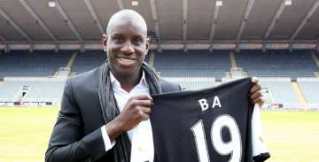 Demba Ba signs for Newcastle.