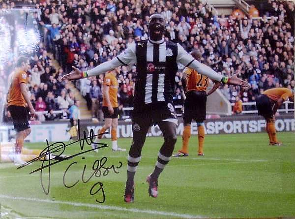 "First prize - 16"" x 12"" signed photo of Papiss Cisse."