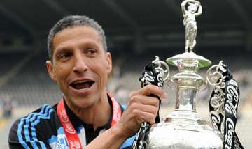 Chris Hughton with Championship trophy.