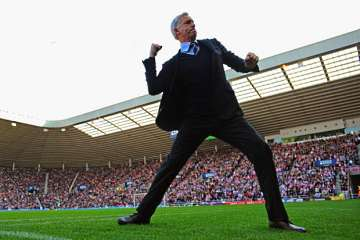 Alan Pardew fist pumping.