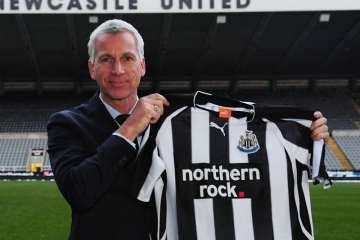 Alan Pardew with Newcastle United shirt.