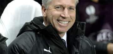 Alan Pardew smiling.