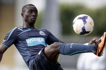 Papiss Cisse in new Wonga shirt.