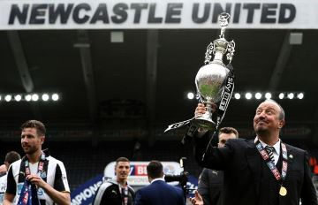 Rafa Benitez with Championship trophy.