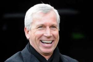 Alan Pardew smiling.