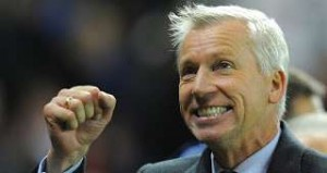Pardew smiling and pumping his little fist with glee.