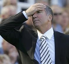 Graeme Souness slaps head in frustration.