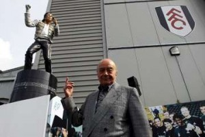 Mohamed al Fayed with Michael Jackson sculpture.
