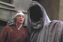 Scrooge and ghost of Christmas.