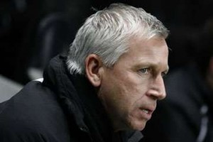 Alan Pardew in the dugout.