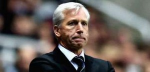 Alan Pardew on the sideline.