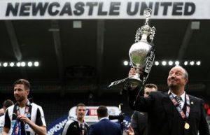 Rafa Benitez with Championship trophy.